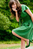 Sweet girl in a green dress — Stock Photo