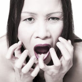 Asian girl looking really scared — Stock Photo