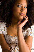 African woman with a hand on her chin — Stock Photo