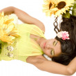 Indian flower girl lying — Stock Photo #12743433