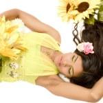 Indian flower girl lying — Stock Photo