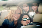 4 girls in the car — Stock Photo
