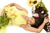 Indian flower girl lying — Stock Photo