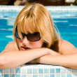 Taking a sunbath in the pool — Stock Photo