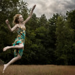 Jumping in the field — Stock Photo