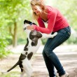 Cute girl and dog — Stock Photo