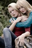 Hugging sisters — Stock Photo