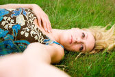 Girl and the green grass — Stock Photo