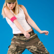 Sexy blond girl dancing — Stock Photo