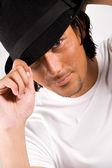 Sexy jongen met een hoed — Stockfoto