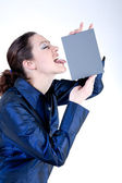 Woman with long curly hair licking a grey card — Stock Photo