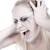 Studio portrait of a screaming young blond woman — Foto Stock