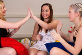 Playing girlish games at pyjama party — Stock Photo