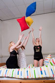 Throwing with pillows at a pyjama party — Stock Photo