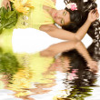 Indian flower girl lying — Stock Photo #12798392