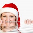 Christmas faerie looking over the edge of a pool — Stock Photo