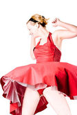 Funny girl in red gala dress dancing — Stock Photo