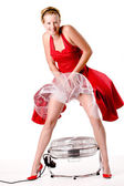 Funny girl in red gala dress that blows up with a ventilator — Stock Photo