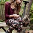 Girl with a cat - Stockfoto