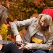 Learning playing guitar - Stock fotografie
