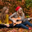 Playing guitar in the woods — Stock Photo