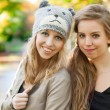 Girlfriends in the autumn — Stock Photo