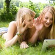 Girls waving with a tablet — Stock Photo