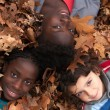 Children and leafs — Photo