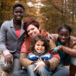 Multiracial family in the autumn - Lizenzfreies Foto
