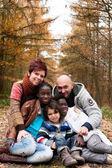 Familie met geadopteerde kinderen — Stockfoto