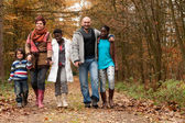 Take a walk with the multicultural family — Stock Photo