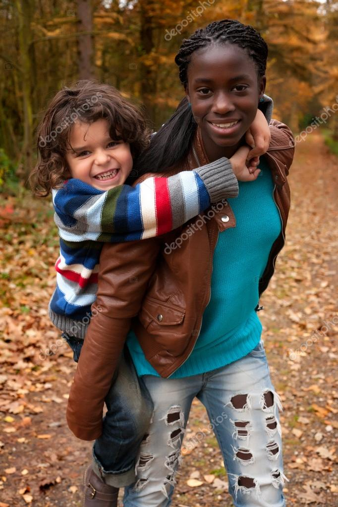 Happy foster children in the forest are having fun  Stock Photo #17692655