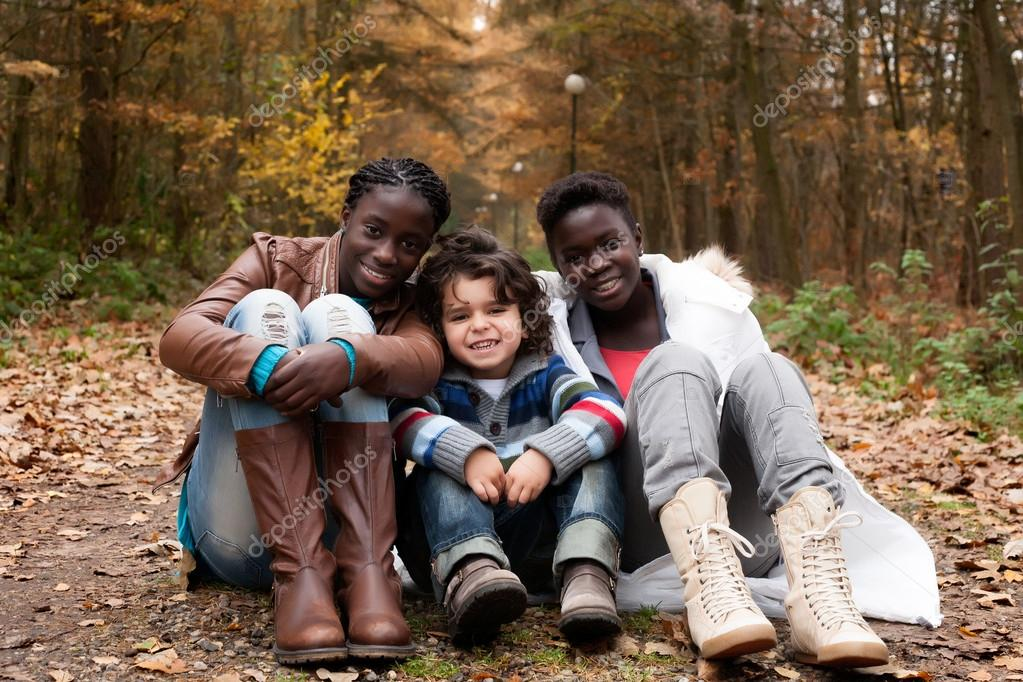 Happy family with foster children in the forest — Stock Photo #17692671