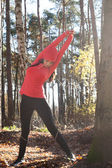 Stretching in the forest — Stock Photo
