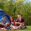 Youth on a camping having a great time — Stock Photo