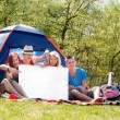 Youth on camping with empty sign board — Stock Photo #26077359