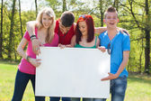 Youth with an empy billboard — Stock Photo