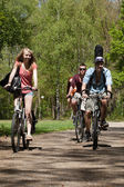 Teenagers riding on bicycles — Stock Photo