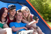 Group taking a picture in the tent — Stock Photo