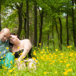 Happy lovers in a buttercup field — Stock Photo