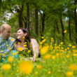 Sweet couple and buttercups — Stock Photo
