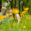 Sweet lovers between the buttercups — Stock Photo