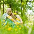 Happy couple in the grass — Stock Photo