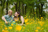 Sweet couple and buttercups — Stok fotoğraf