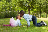 African boy is kissing his sister — Stock Photo