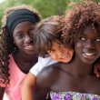 Smiling boy and the ethnic sisters — Stock Photo