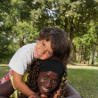 Nice little boy and his black sister — Stock Photo