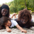 Smiling ethnic children on the beach — Stock Photo