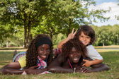 Multi ethnic children and peace sign — Stock Photo