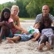 Multicultural family on the beach — Stock Photo
